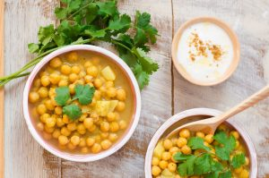 Two bowls of chickpea soup, with fresh coriander